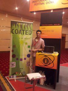 محمد عبدالمنعم ولعبته Coated في معرض IGF 2013 في شنجهاي.